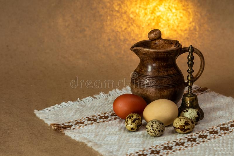 Festive Easter still life with eggs and earthenware jug. Blank for postcards stock image