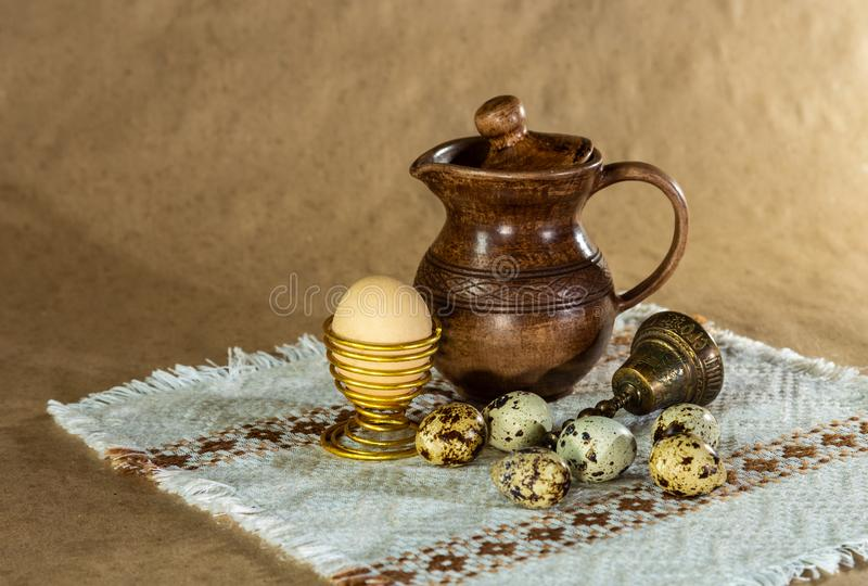 Festive Easter still life with eggs and earthenware jug. Blank for postcards stock photo