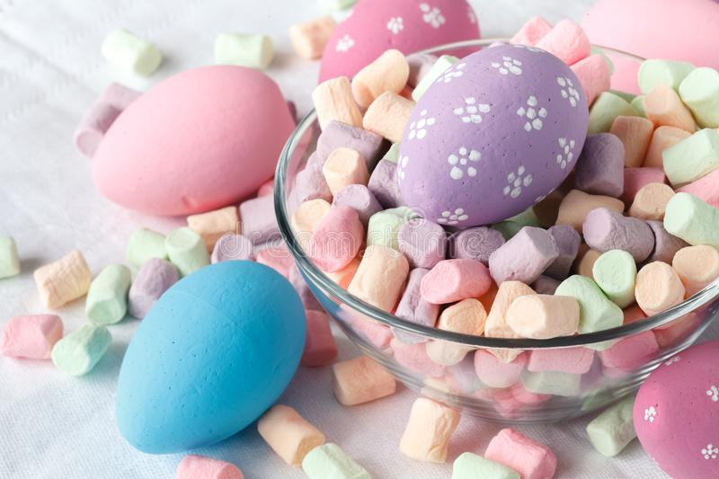 Festive eastern egg with candy stock image