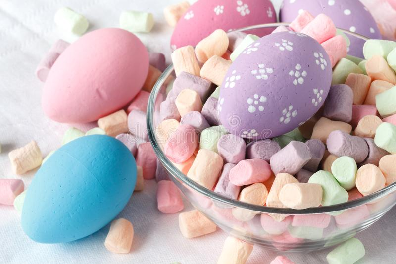 Festive eastern egg with candy stock images