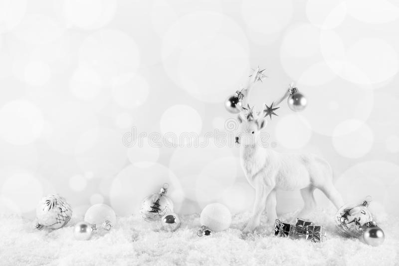 Festive elegant christmas background in white an silver colors w. Ith deer on snow stock photo