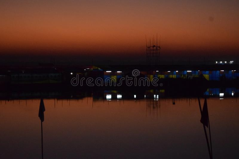 Festive Evening in the Edge of a River stock photos