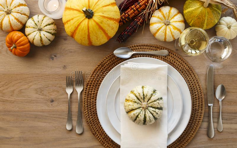 Festive Fall Thanksgiving table setting place setting home decor stock photo