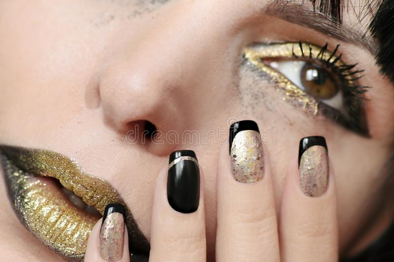 Festive fashion black gold make up and French manicure royalty free stock image