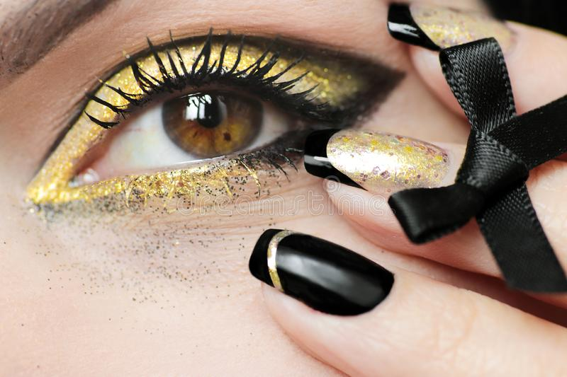 Festive fashion black gold make up and French manicure stock photos