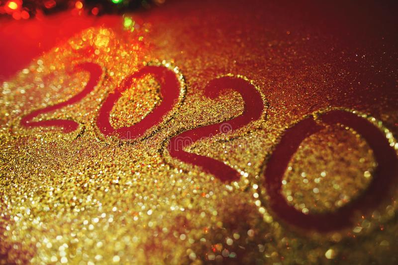 Festive figure 2020, written on a claret background with sparkles. New Year`s concept.  royalty free stock photos