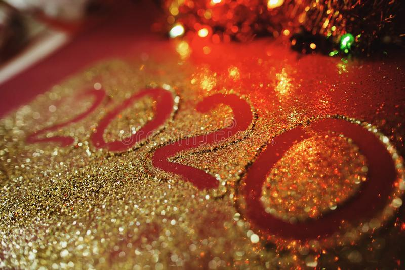 Festive figure 2020, written on a claret background with sparkles. New Year`s concept.  stock photos