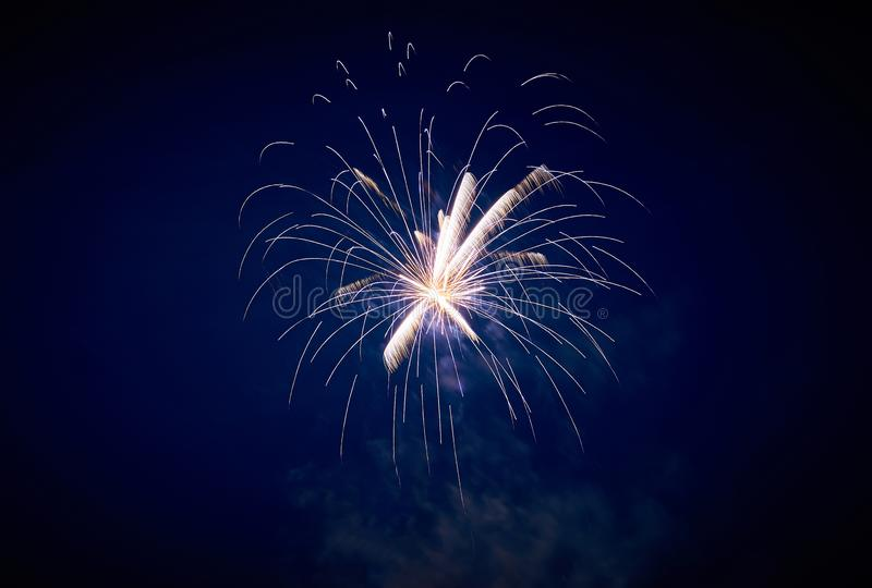 Festive fireworks against the night sky of white and blue royalty free stock photo