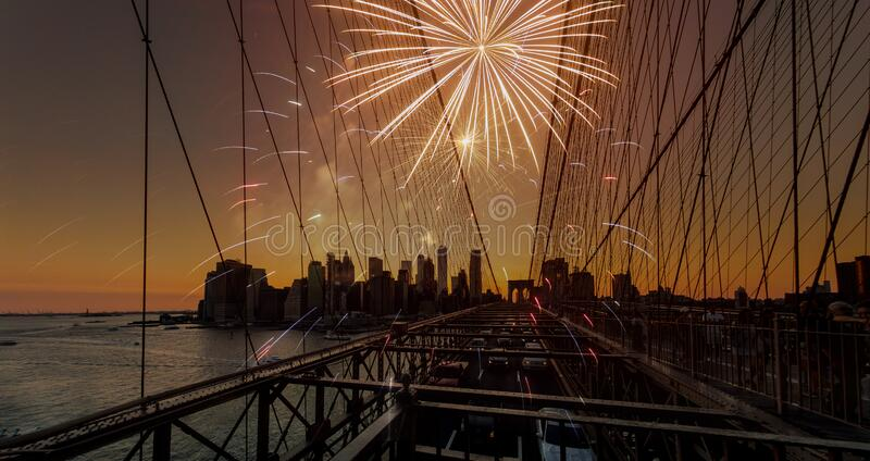 Festive fireworks on a Brooklyn Bridge sunset with Manhattan skyline. In New York royalty free stock photography