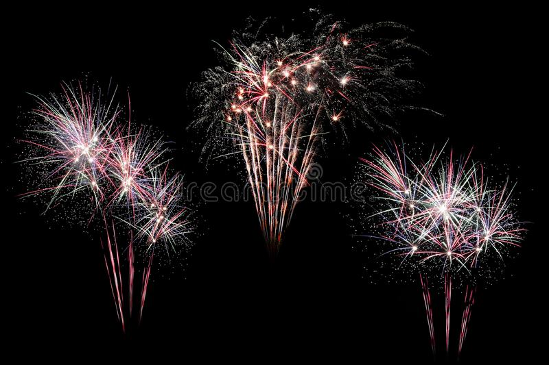 Festive fireworks colorful display isolated in bursting shapes on black background. Beautiful light for celebration. Show explosio stock image