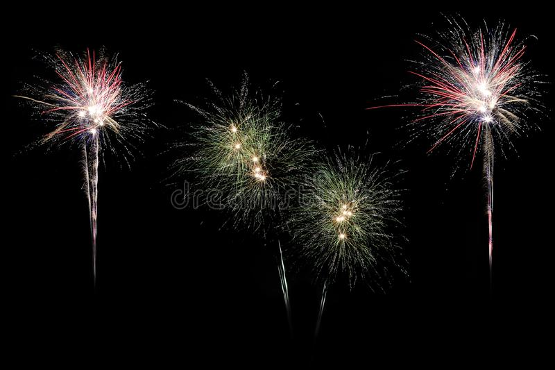 Festive fireworks colorful display isolated in bursting shapes on black background. royalty free stock photo