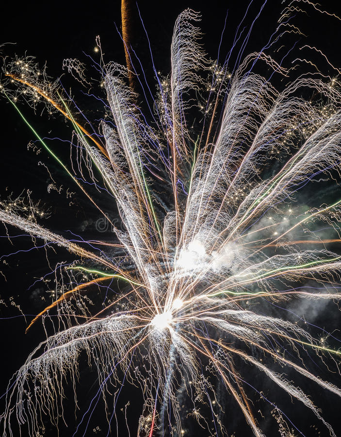 Festive fireworks. Fireworks and decorative lights a variety of colors and shapes produced by combustion of pyrotechnic compositions. Fireworks were invented royalty free stock photos