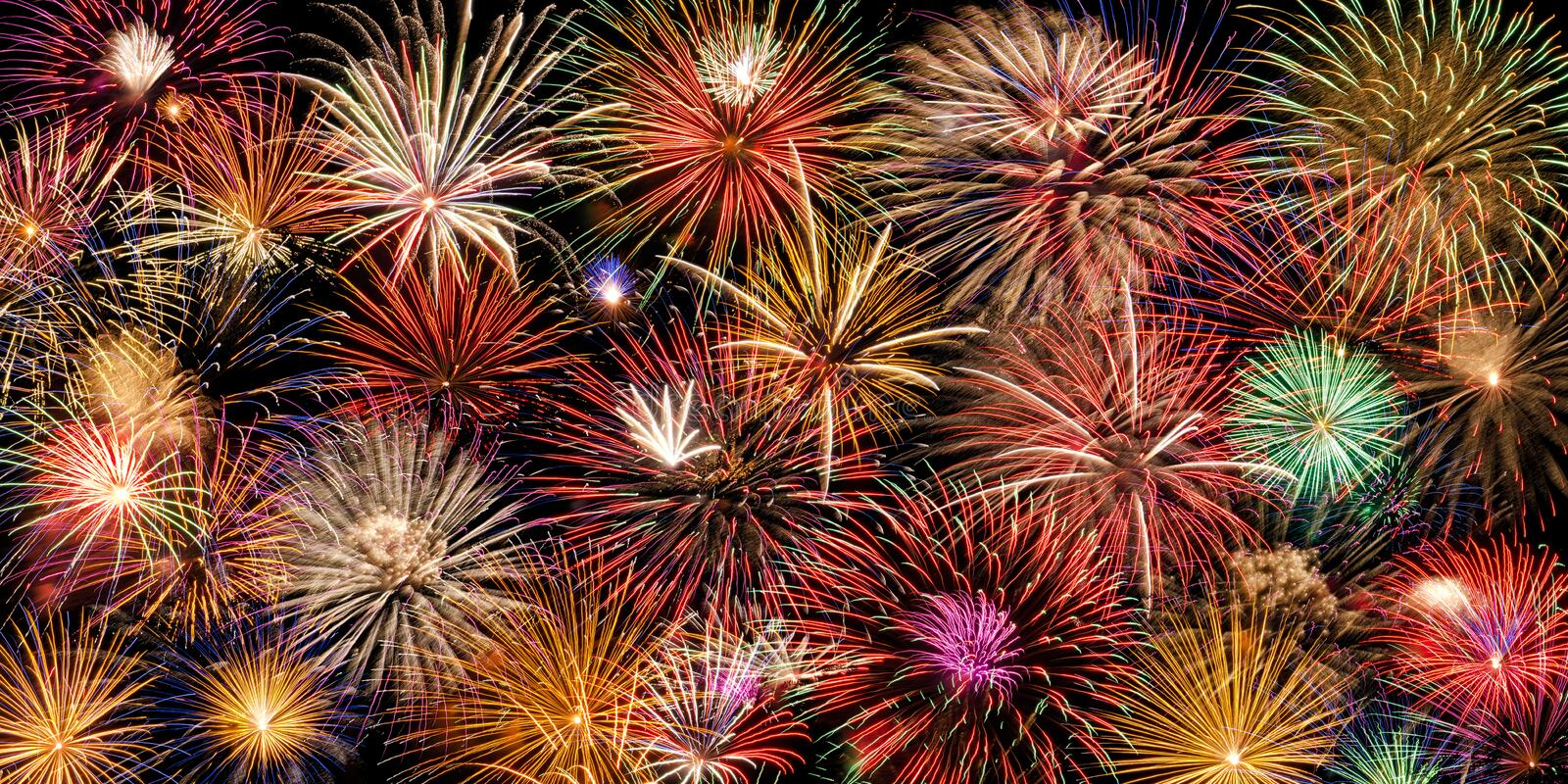 Festive fireworks display. Festive and colorful fireworks display stock photo
