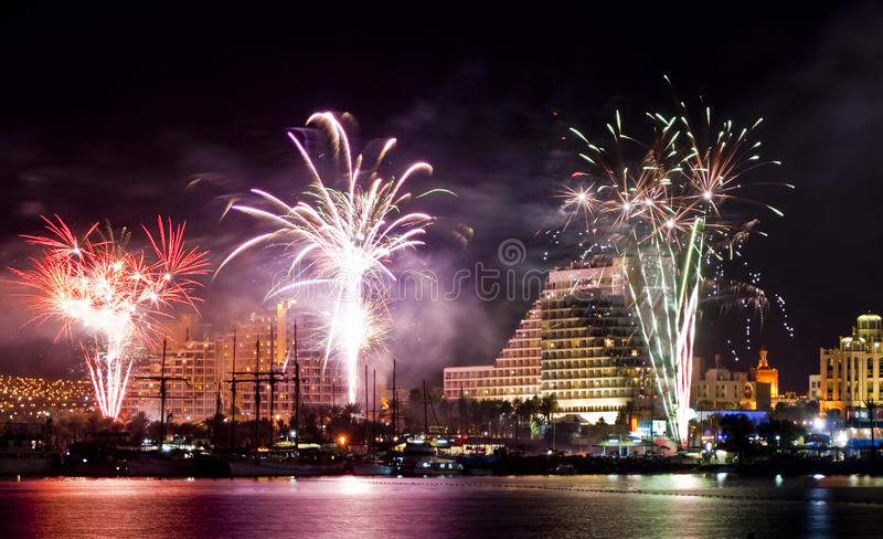 Festive fireworks in Eilat city, Israel. During holidays and celebrations there are beautiful festive fireworks on the main promende of Eilat city in Israel stock image