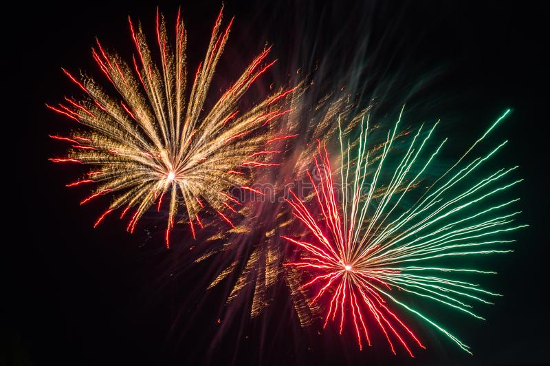 Festive fireworks. Fireworks and decorative lights a variety of colors and shapes produced by combustion of pyrotechnic compositions. Fireworks were invented royalty free stock image
