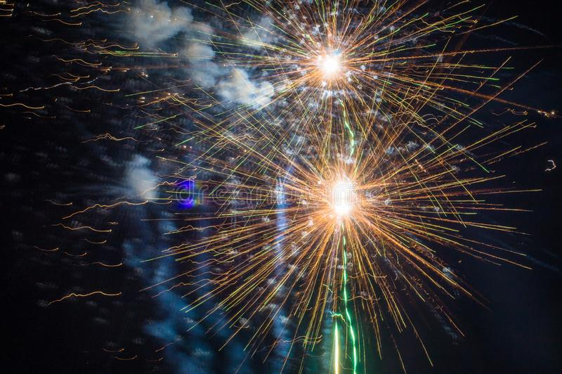 Festive fireworks. Fireworks and decorative lights a variety of colors and shapes produced by combustion of pyrotechnic compositions. Fireworks were invented royalty free stock photo