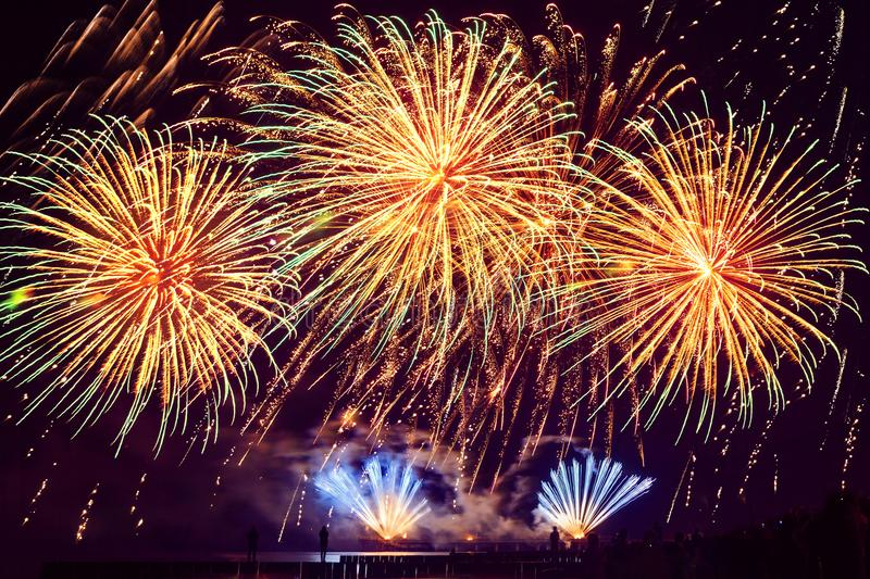 Holiday fireworks of golden color on a black sky background stock photography
