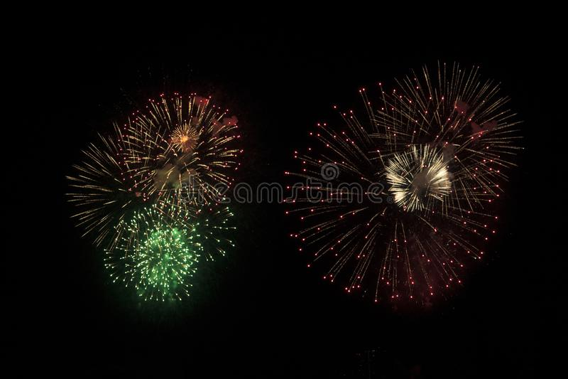 Festive fireworks in the night sky. Festive fireworks on the night sky background, new, july, explosion, year, isolated, golden, celebration, red, festival, 4th stock images