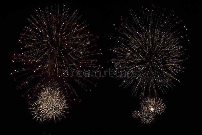 Festive fireworks in the night sky. Festive fireworks on the night sky background, new, july, explosion, year, isolated, golden, celebration, red, festival, 4th stock photography