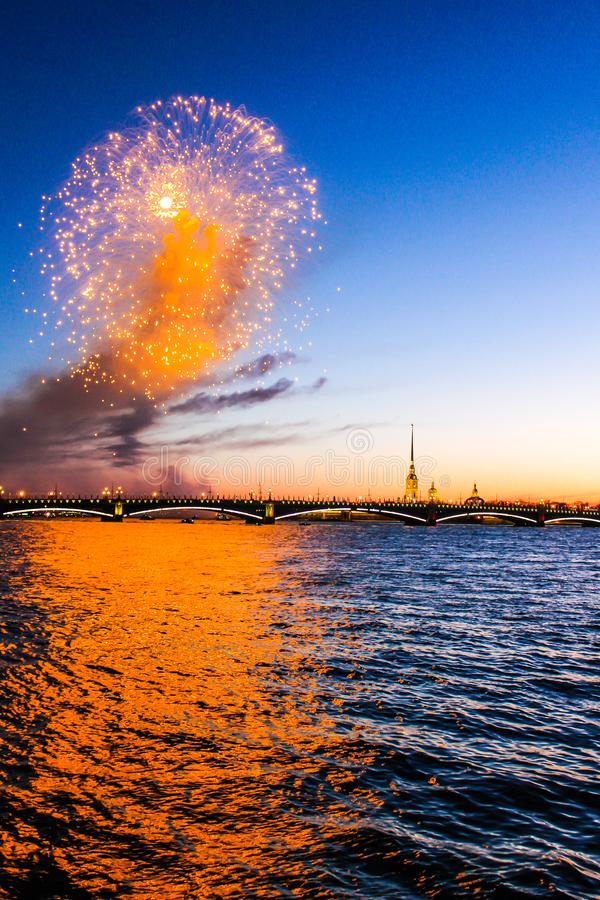 Festive fireworks on the waterfront at sunset. Neva river stock photography
