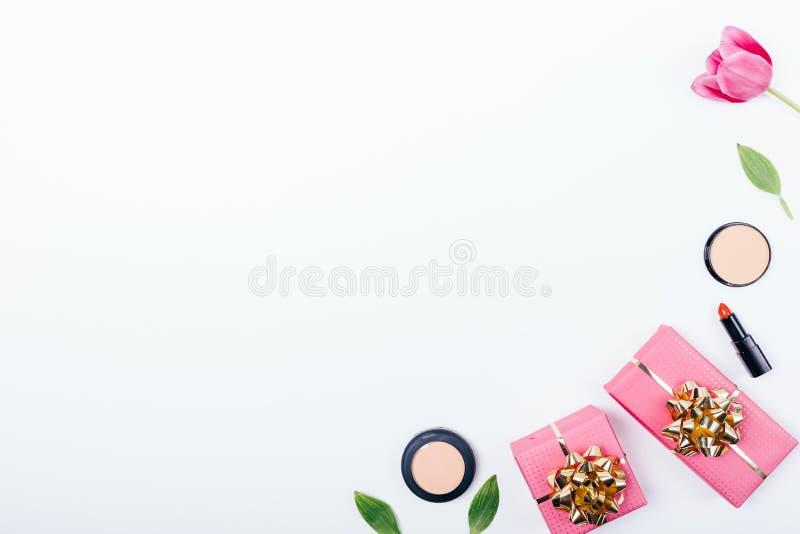 Festive flat lay composition of feminine cosmetics stock photo