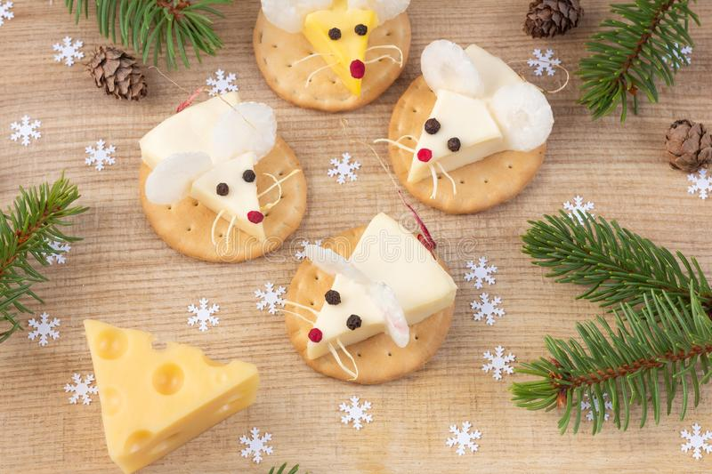Festive food for the New Year 2020 - year of the white mouse rat. Mice shaped cheese appetizer. Christmas mood stock photos