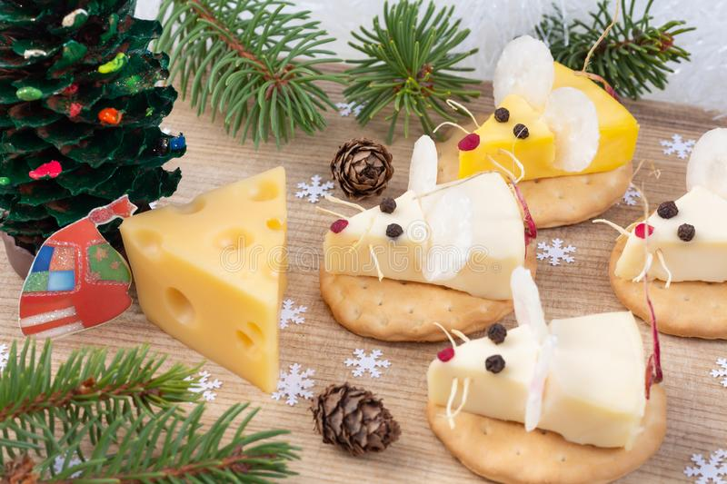 Festive food for New Year 2020 - year of the white rat. Mice shaped cheese appetizer. Xmas mood. A gift for a mouse under the royalty free stock images