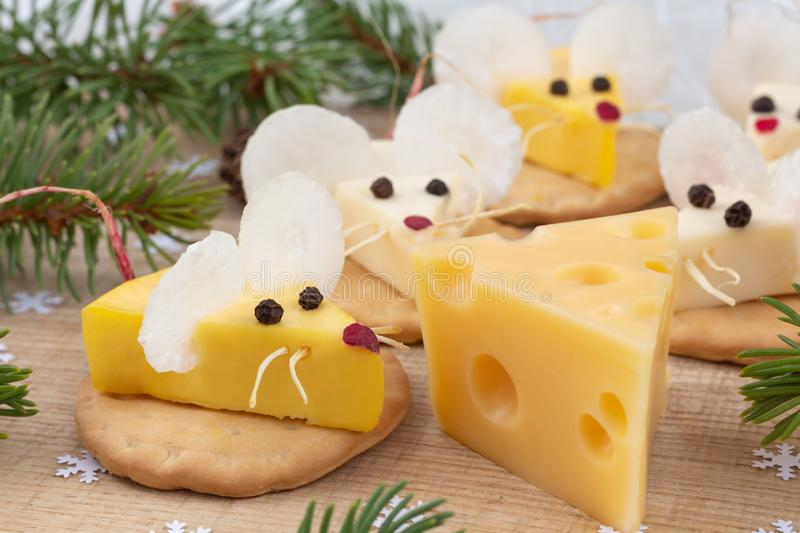 Festive food for the New Year 2020. Year of the white rat. Mouse shaped cheese appetizer. Christmas mood stock photos