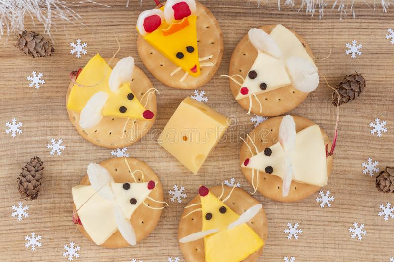 Festive food for the New Year 2020 - the year of white rat. Mice around a piece of cheese. Appetizer. stock photography