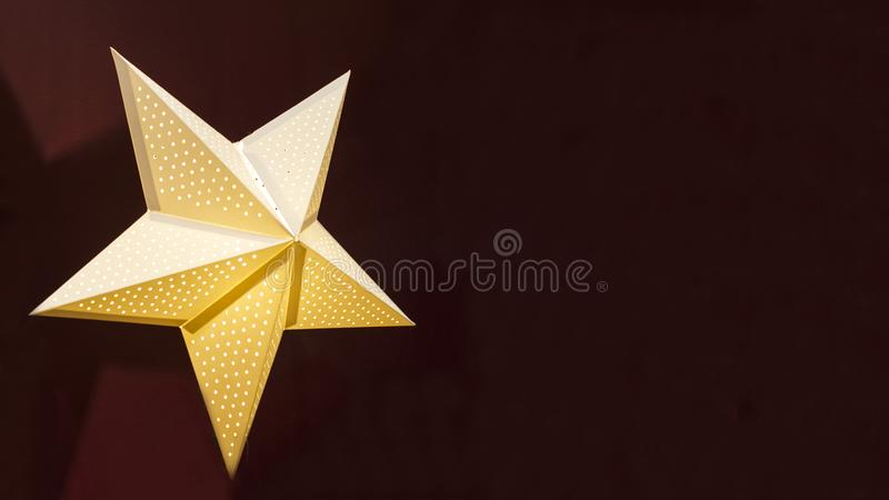 Festive garland in the form of a star with light for Christmas, New Year, holiday on dark red background. home decor. Copy space, banner, mock up, text royalty free stock photos