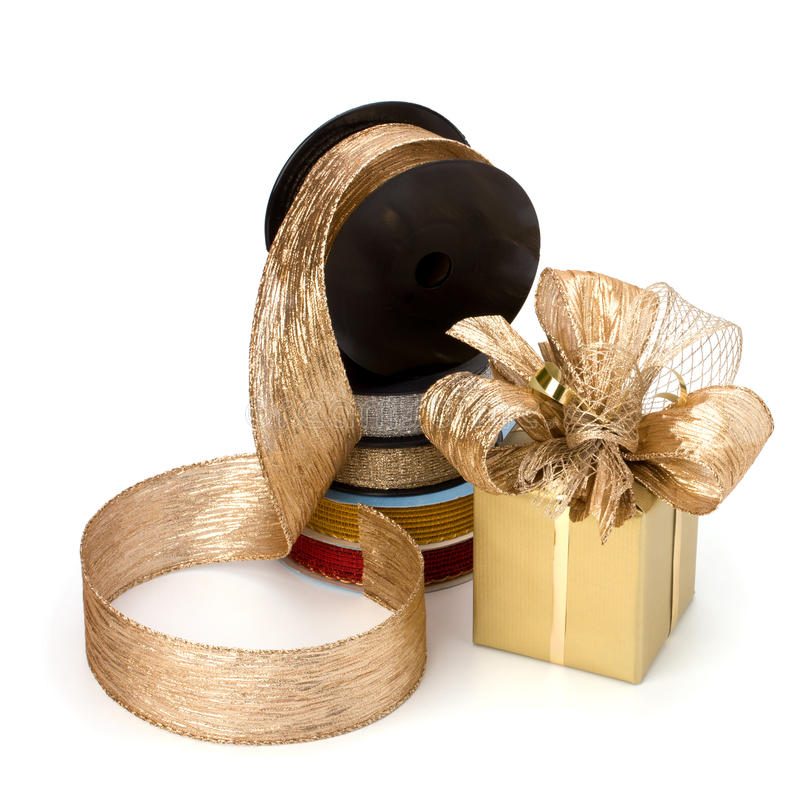Festive gift box and wrapping ribbons royalty free stock photography