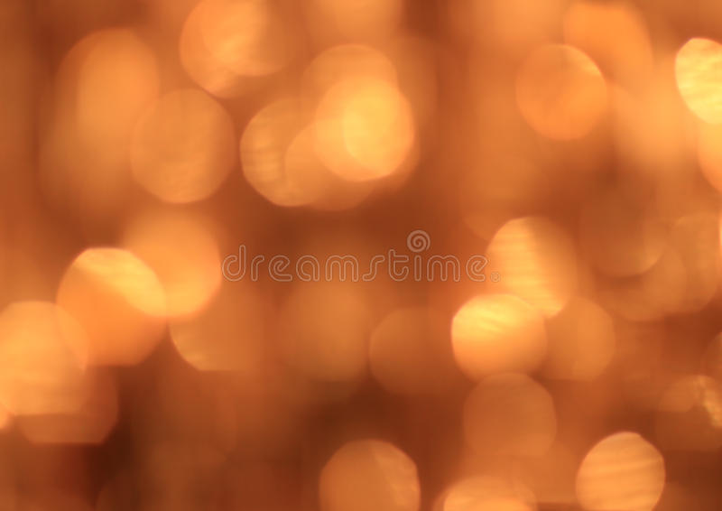 Festive gold background with bokeh effect royalty free stock images
