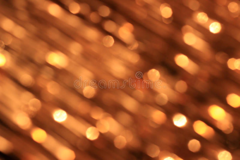Festive gold background with bokeh effect royalty free stock photo