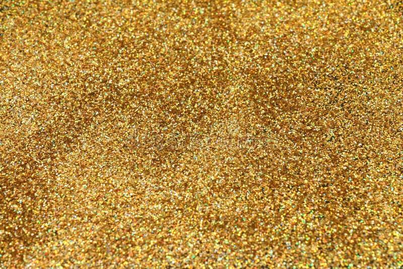 Festive gold glitter background stock image