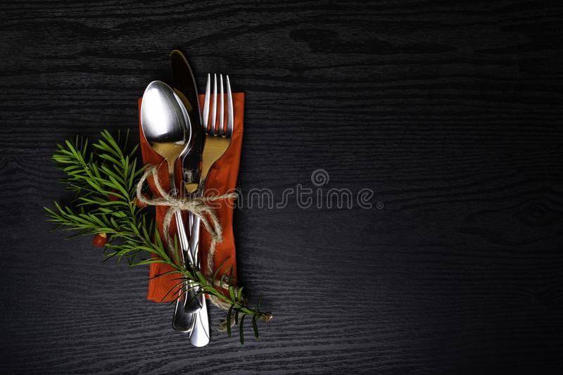Winter holiday dinner plate decoration on black wood background. table set with a winter, Christmas decoration. Winter holiday the royalty free stock images