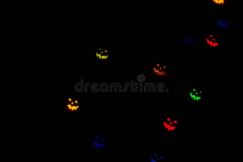 Festive Halloween background with natural bokeh in shape of Halloween emoticons and bright lights. Party background royalty free stock photography