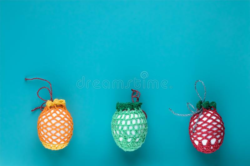 Festive happy easter card. Concept christian tradition. Paschal gift card from colorful easter eggs with сopy space on blue backg stock photos