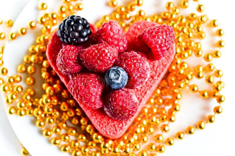Festive heart-shaped cake royalty free stock photography