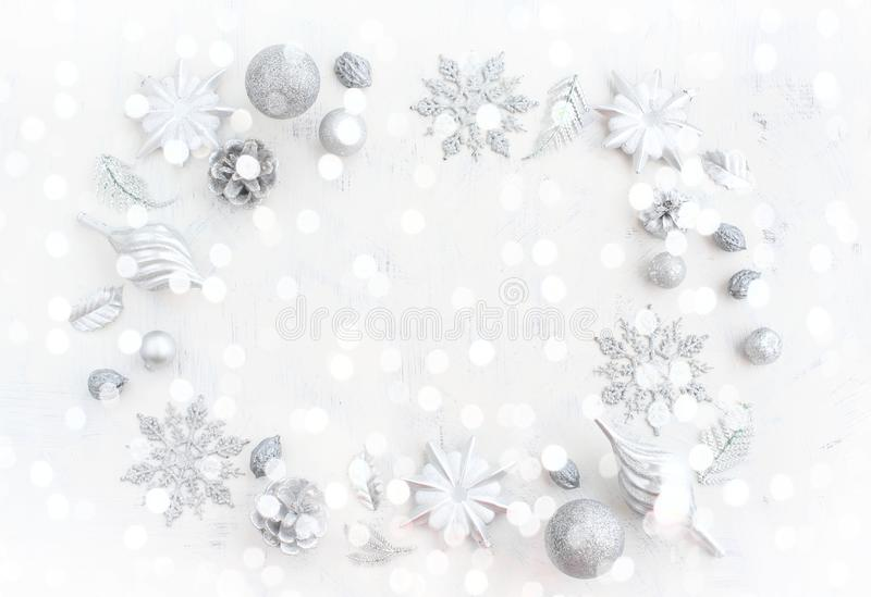 Festive holiday background with light delicate bokeh effect and drawing Decorative snow. stock image