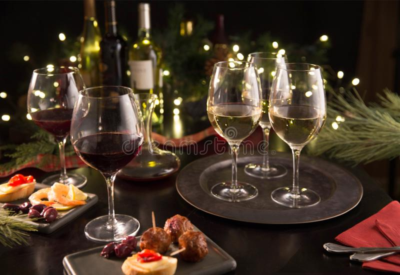 Festive holiday gathering wine party with appetizers stock photography