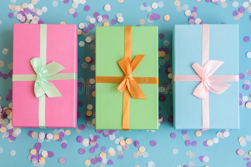 Festive holiday New Year and Christmas blue background with gift boxes, confetti, . Concept of carnival, birthday, party royalty free stock images