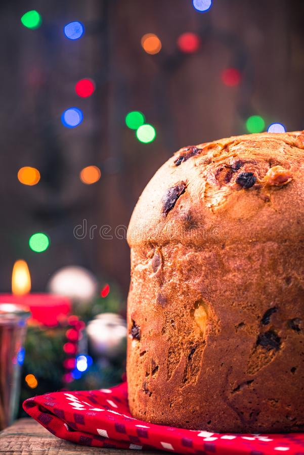 Festive homemade panettone cake on Christmas table. Panettone cake on festive table. Traditional Christmas food royalty free stock images