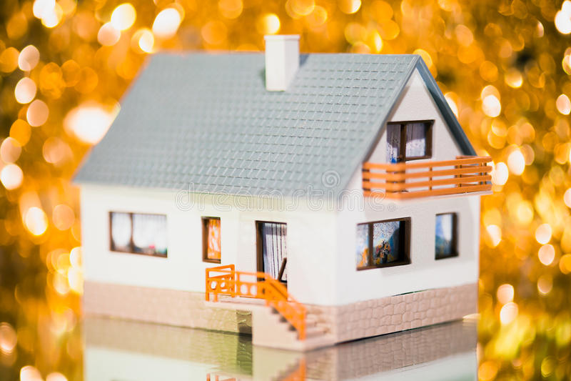 Festive house. Against golden bokeh background royalty free stock image