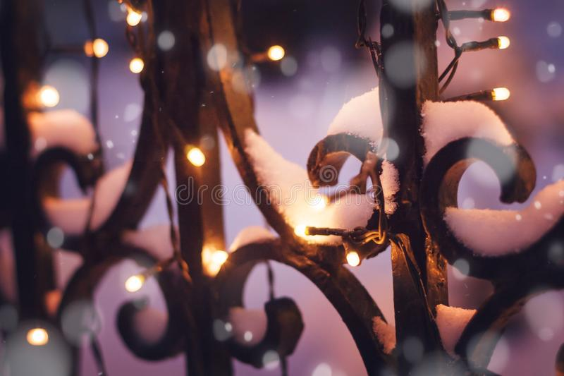 Festive illumination on the fence in the evening winter time, ab royalty free stock image