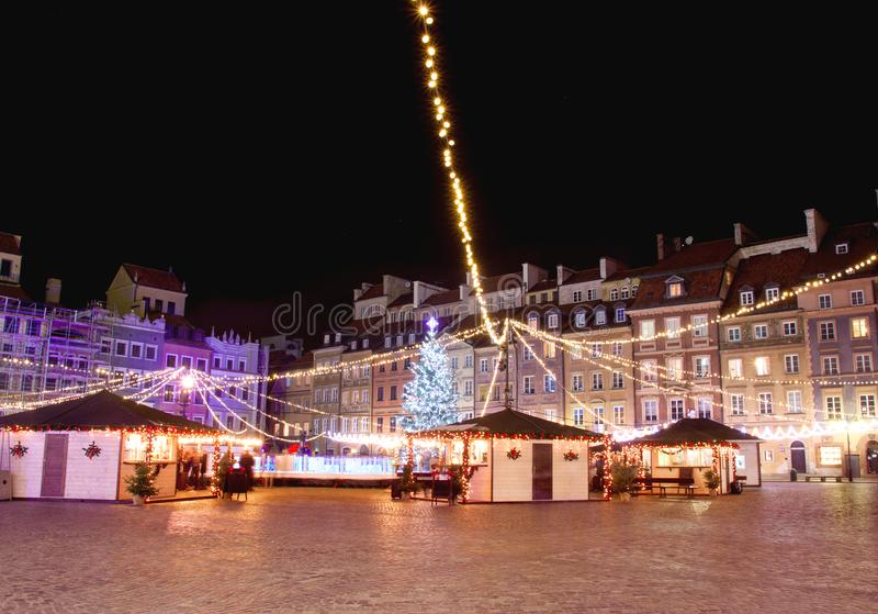 Festive market at Market Square in Warsaw at night. Festive market at Market Square in Warsaw at the night stock photo