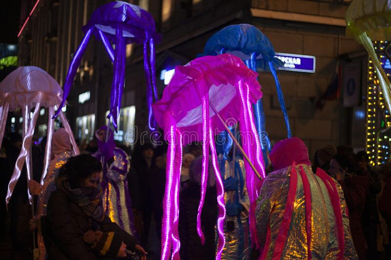 Festive masquerade. Glowing jellyfish in the form of an umbrella. stock images