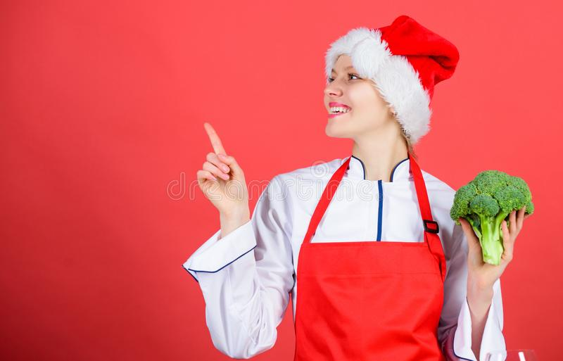 Festive menu concept. Christmas dinner ideas. Christmas menu. Woman chef cooking christmas dinner wear santa hat. Best. Christmas recipes. Enjoy easy ideas for royalty free stock photo