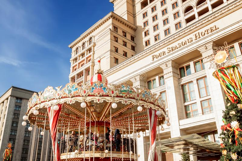 Festive merry-go-round at the Pancake Week fair in Moscow on Manezhnaya Square. royalty free stock photography