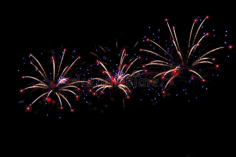 Festive multicolored fireworks on black background royalty free stock photography