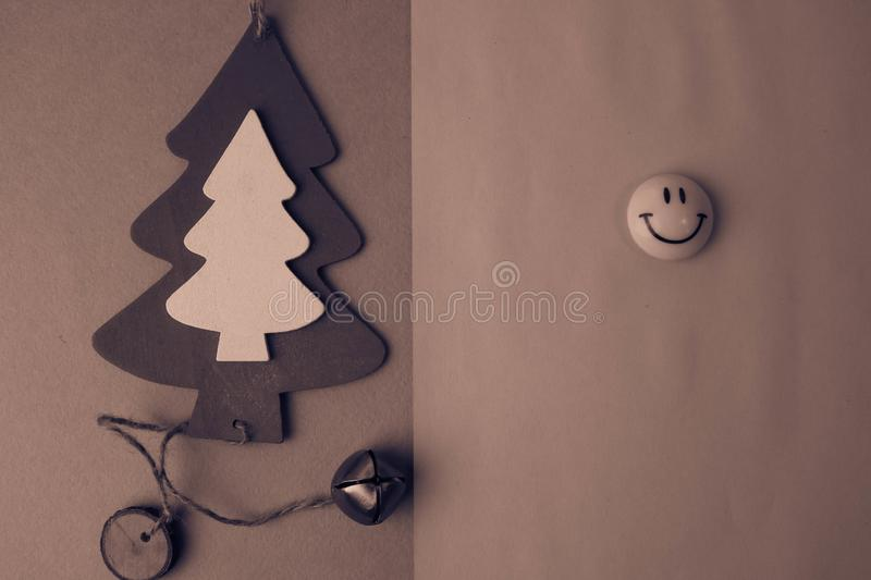 Festive New Year`s Christmas small toy wooden homemade tree and a round smiling emoticon. Flat lay. Top view. Holiday decorations. Festive New Year`s Christmas royalty free stock photography
